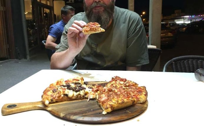 Dave enjoying pizza